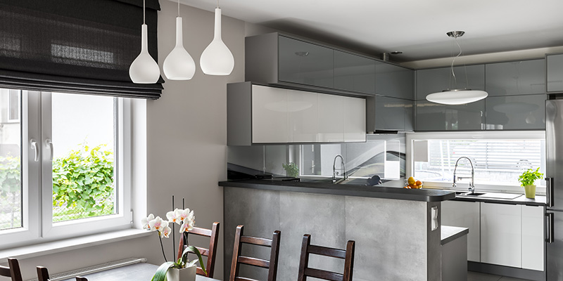 Simple dining set decorative pendant lamp and roller blinds light open kitchen in the background