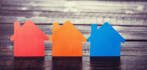 3 paper houses representing the basics of buying a home.