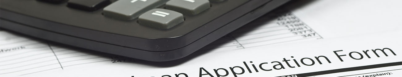 mortgage loan application form the pen and a calculator.