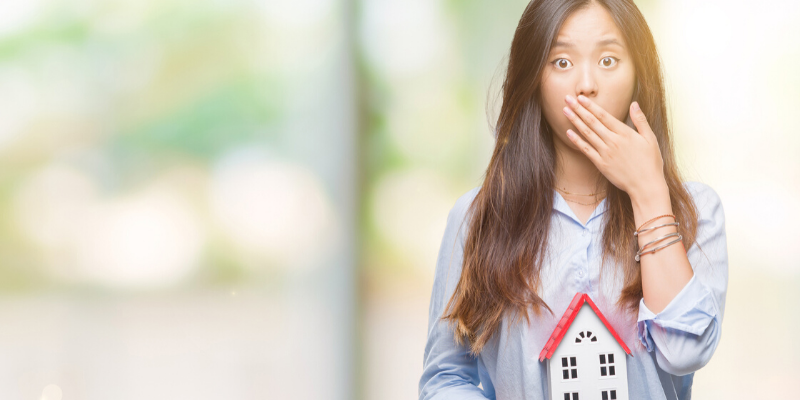 Young female homebuyer shocked after making a mistake during the mortgage loan process.